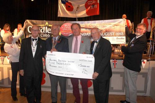 The president of the Rotary Club of Lyme Regis Peter Fortnam and Rotarian Richard Cridge (centre) present a cheque for £5,000 to chairman of the Lyme Regis branch of the Royal British Legion Ian Marshall (left) and president Philip Evans MBE (right)