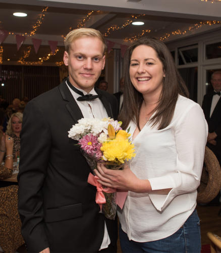Golf club secretary Melissa McMahon is presented with flowers