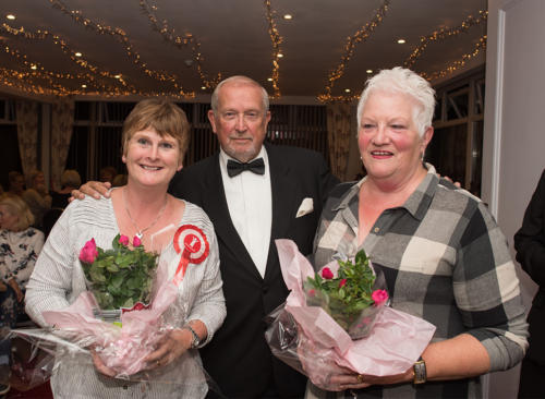 Jayne Jones and Helen Iles from Save the Children receive bouquets from Philip Evans MBE