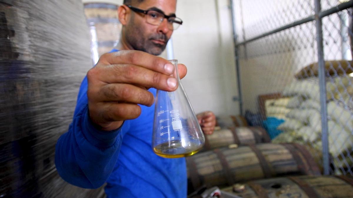 Ivan Torres Sampling Rum at the Distillery