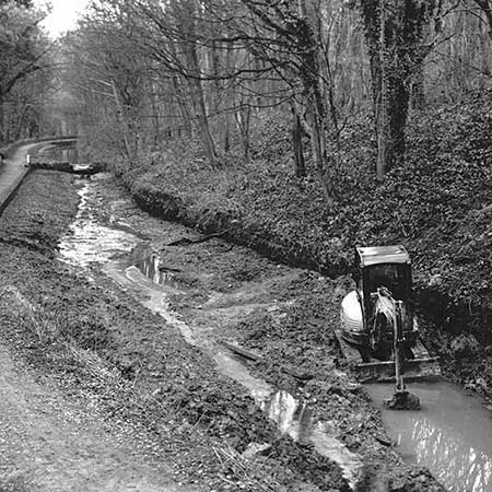A digger working in a section of Cromford Canal.