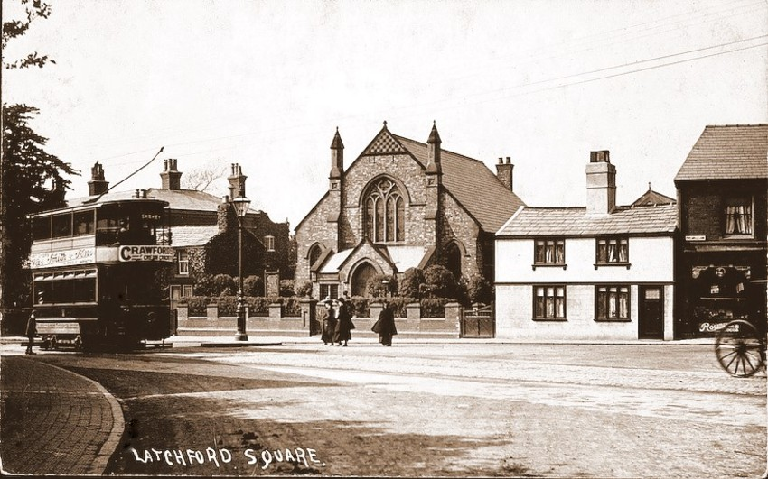 Latchford Square with the church and caretakers cottage in the background. Year 1900's