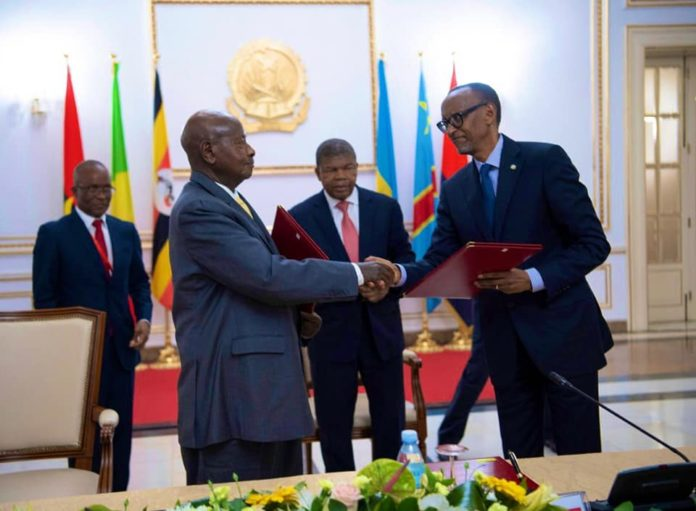 President Museveni and Kagame sign