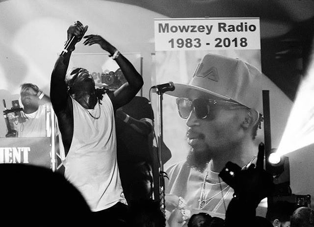 Late Mowzey Radio's grave fans and tourists File Photo