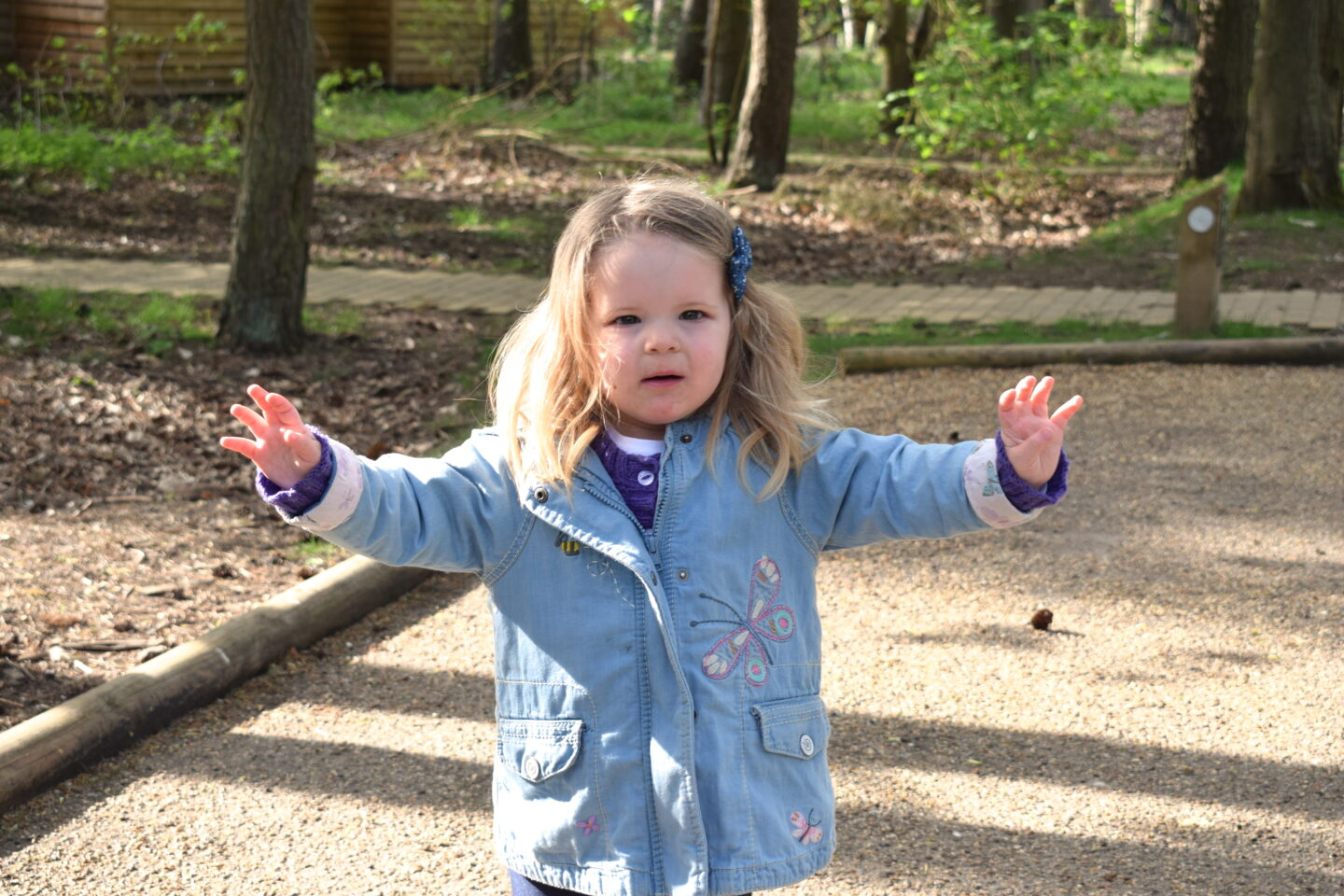 two year old girl running with arms out at Center Parcs Elveden Forest