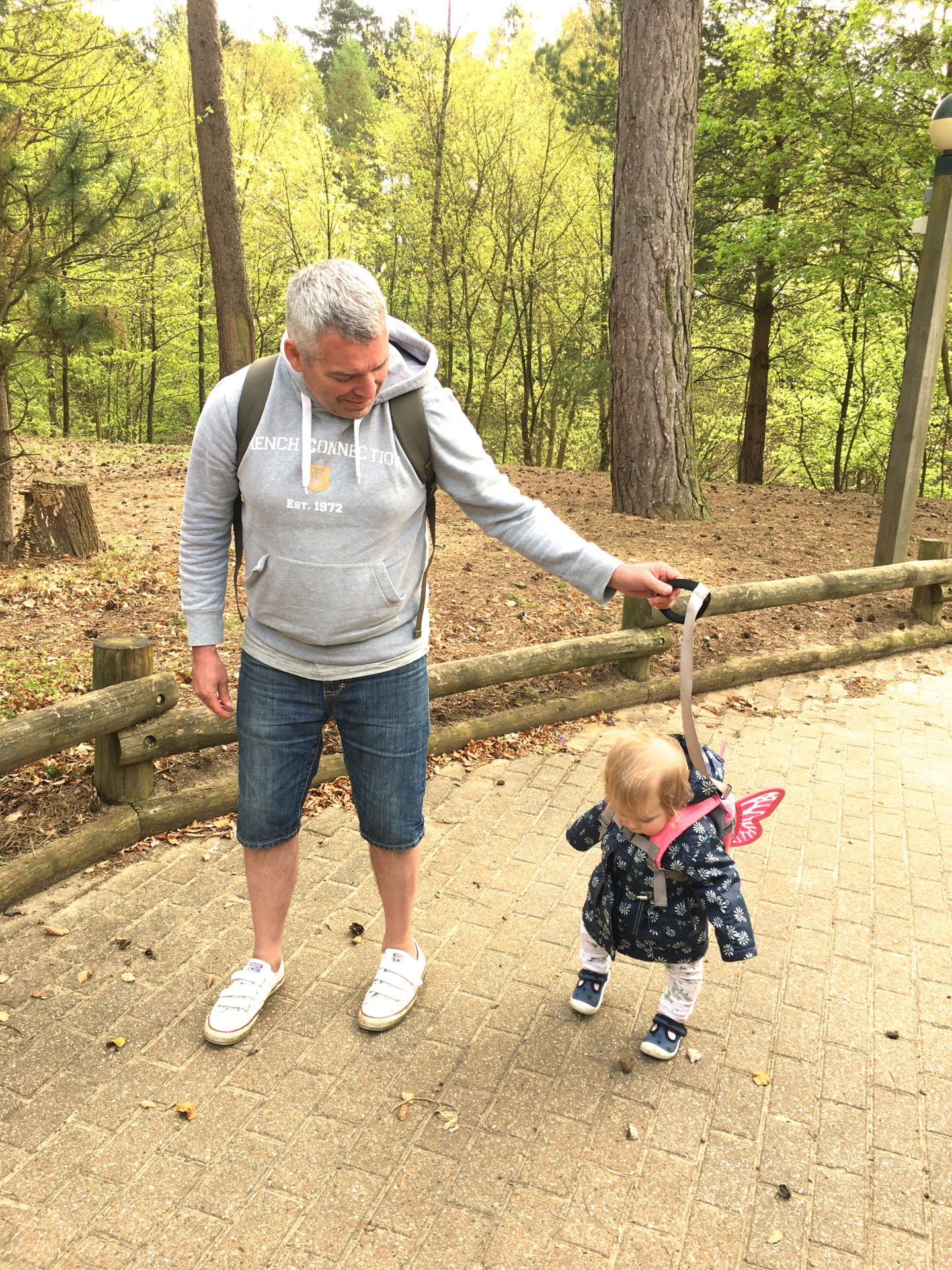 toddler walking with daddy at Center Parcs Elveden Forest