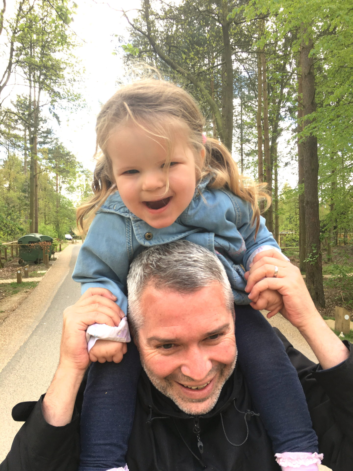 two year old sitting on dad's shoulders at Center Parcs Elveden Forest