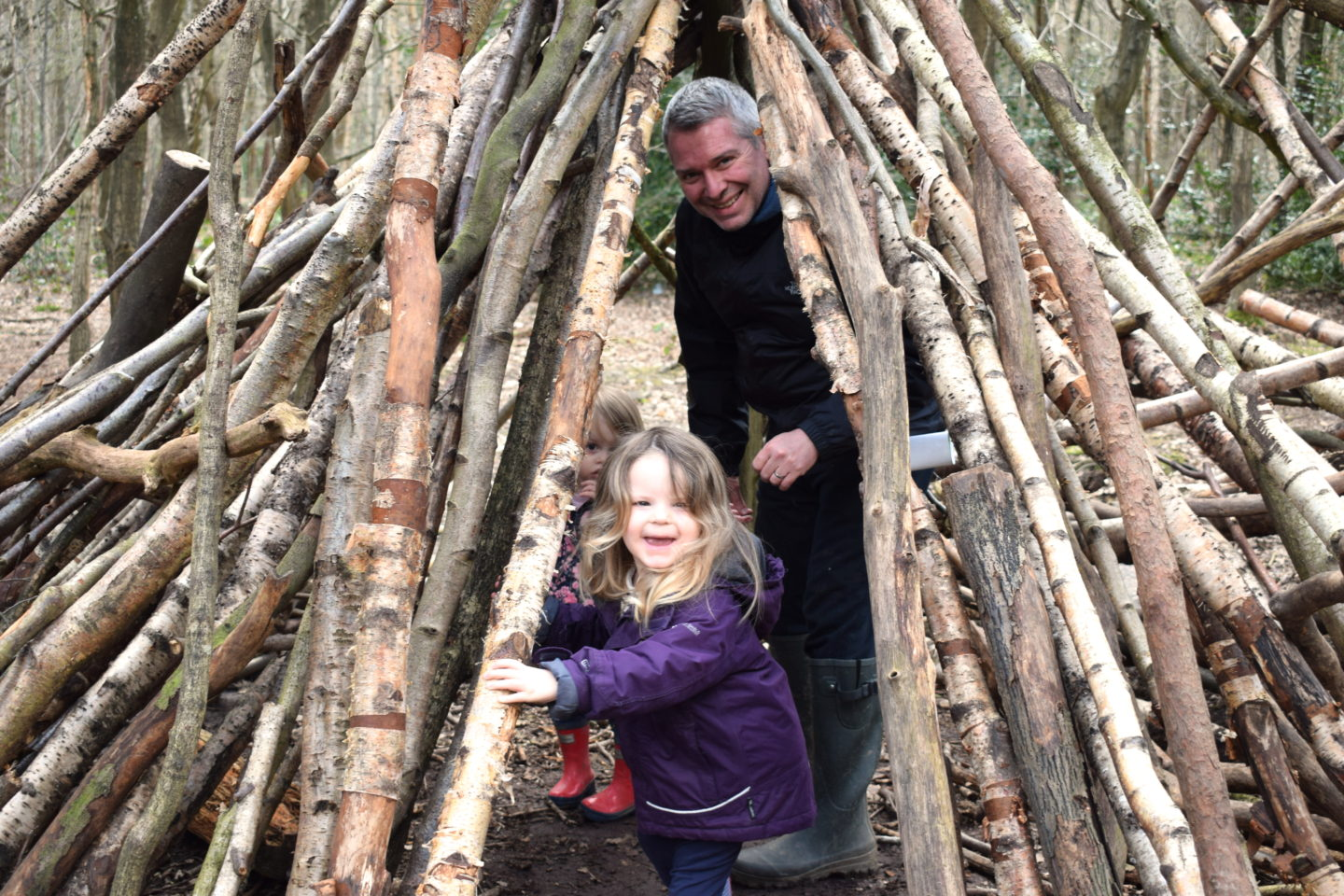 The Gruffalo Trail, Essex, log teepee with father and two daughters inside