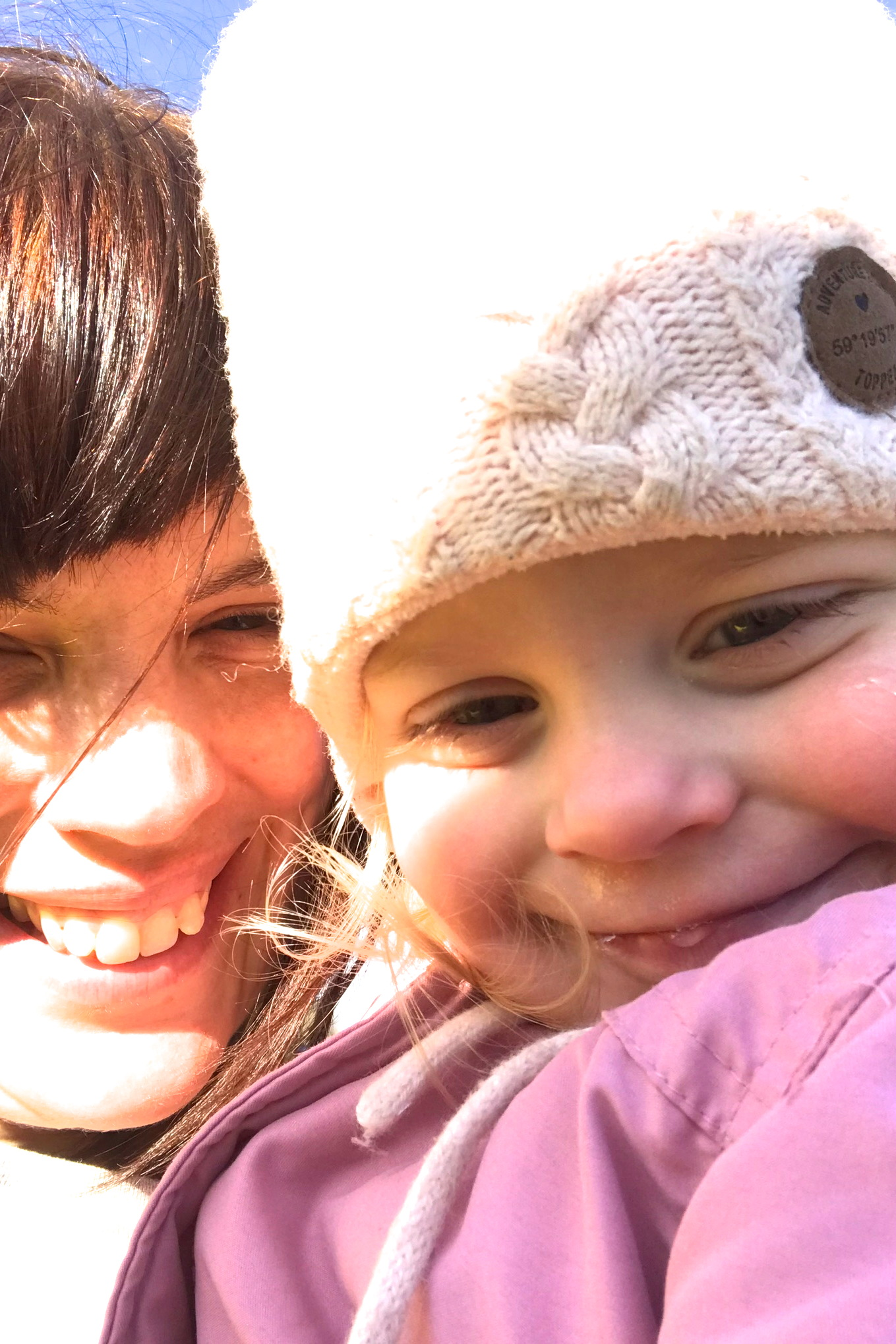 Two year old smiling in selfie with mother