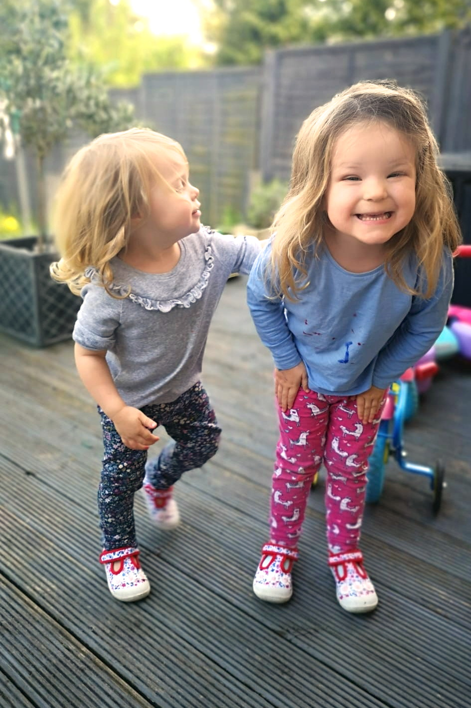 two young sisters playing outside
