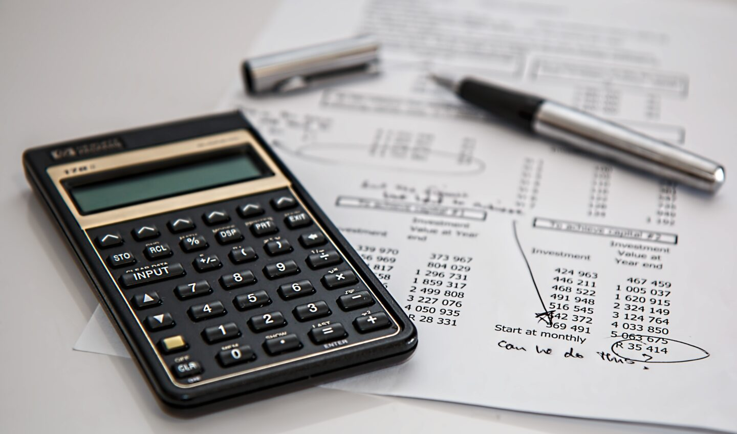 calculator and money budgeting sheet with pen