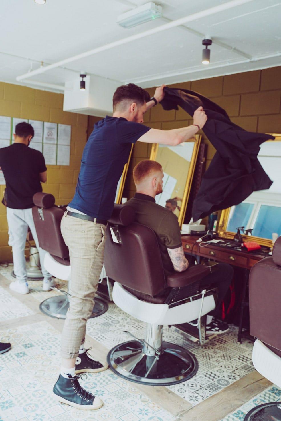 Student training at Strap & Scraper London Barber Academy