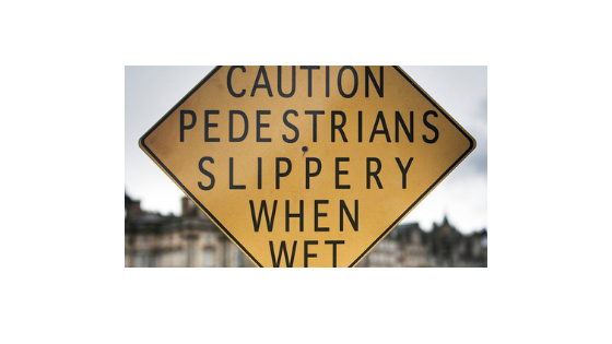 Comma placement fails | Road Sign | Caution pedestrians slippery when wet