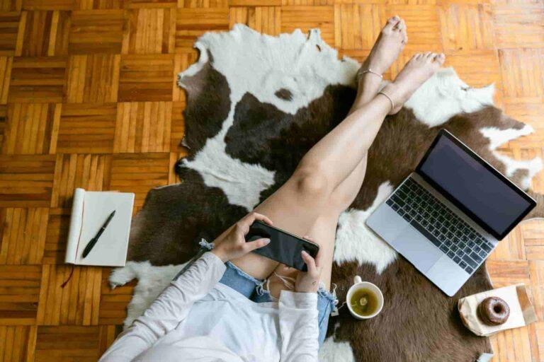 lady sitting on a cowhide rug