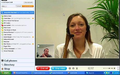 A teacher using Skype to teach English