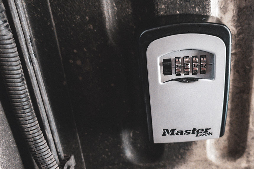 Master Lock Key Safe connected to the underside of a van