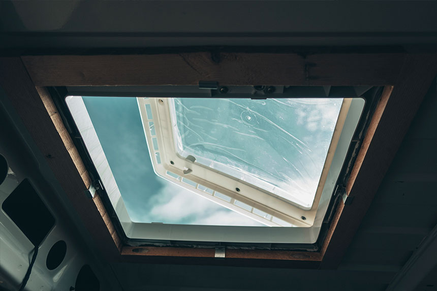 Looking through the bottom of the Thule Omnivent that we installed in the roof of our van conversion
