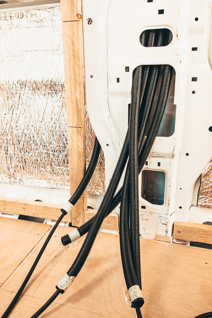Conduit tubing coming out of the internal van walls for wiring