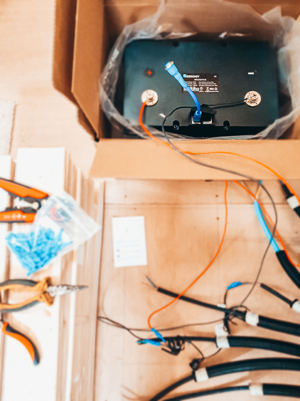 A Renogy Lithium Battery wired up to our lighting wires ready to be tested