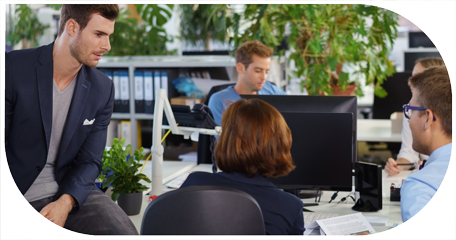 image for sales support recruitment in customer centric recruitment showing colleagues in an office conversing