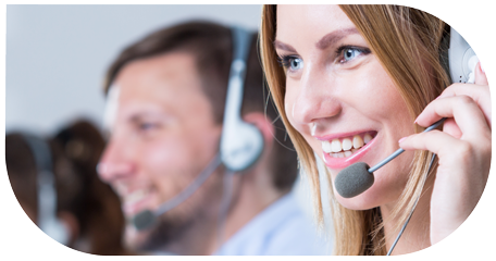 image for customer service and call centre recruitment in customer centric recruitment showing smiling young woman and colleagues in the background in call centre with earphones talking via computer