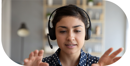 image for marketing recruitment in customer centric recruitment  showing smiling young woman with earphones talking via computer