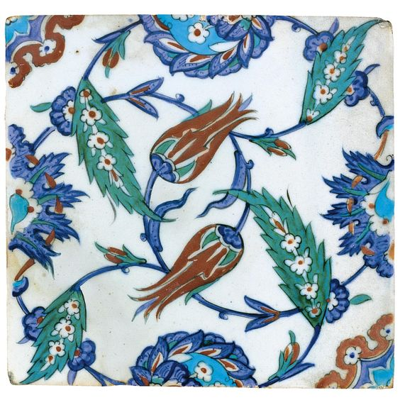 An Iznik Polychrome tile, Turkey, circa 1575 of square form painted in underglaze cobalt blue, viridian green, turquoise and relief red, outlined in black with tulips, saz and composite lotus and saz palmettes issuing from scrolling tendrils. Sotheby's