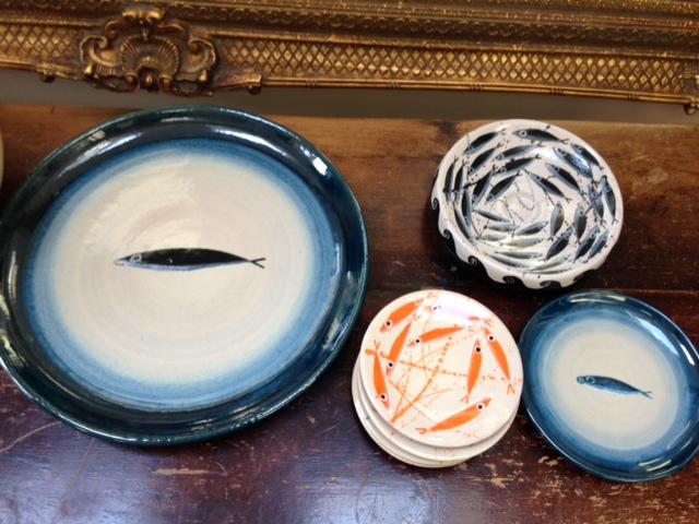 Plates from Rococo interiors's ceramic collection. She bought these ones in person from the artist's studio on her honeymoon on Italy's Amalfi coast.