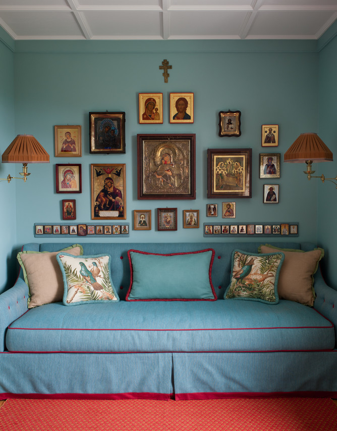 A storybook country house by Kirill Istomin. The client's collection of Russian icons is displayed in the daughter's study. The throw pillows are Lee Jofa and the cotton woven rug is from Vandra Rugs. WSJ