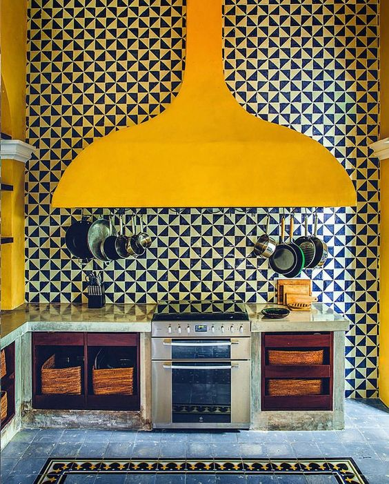Bright Yellow on black and white tiles in this kitchen in Merida, Mexico, photographed by @matthieusalvaing for Cabana Issue
