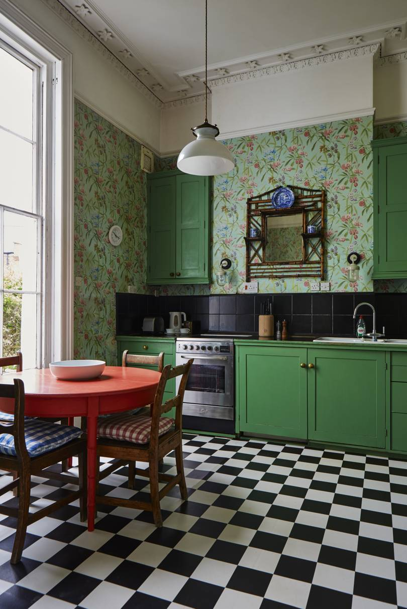green kitchen with floral wallpaper featured in Ros Byam Shaw book Perfect English Townhouse