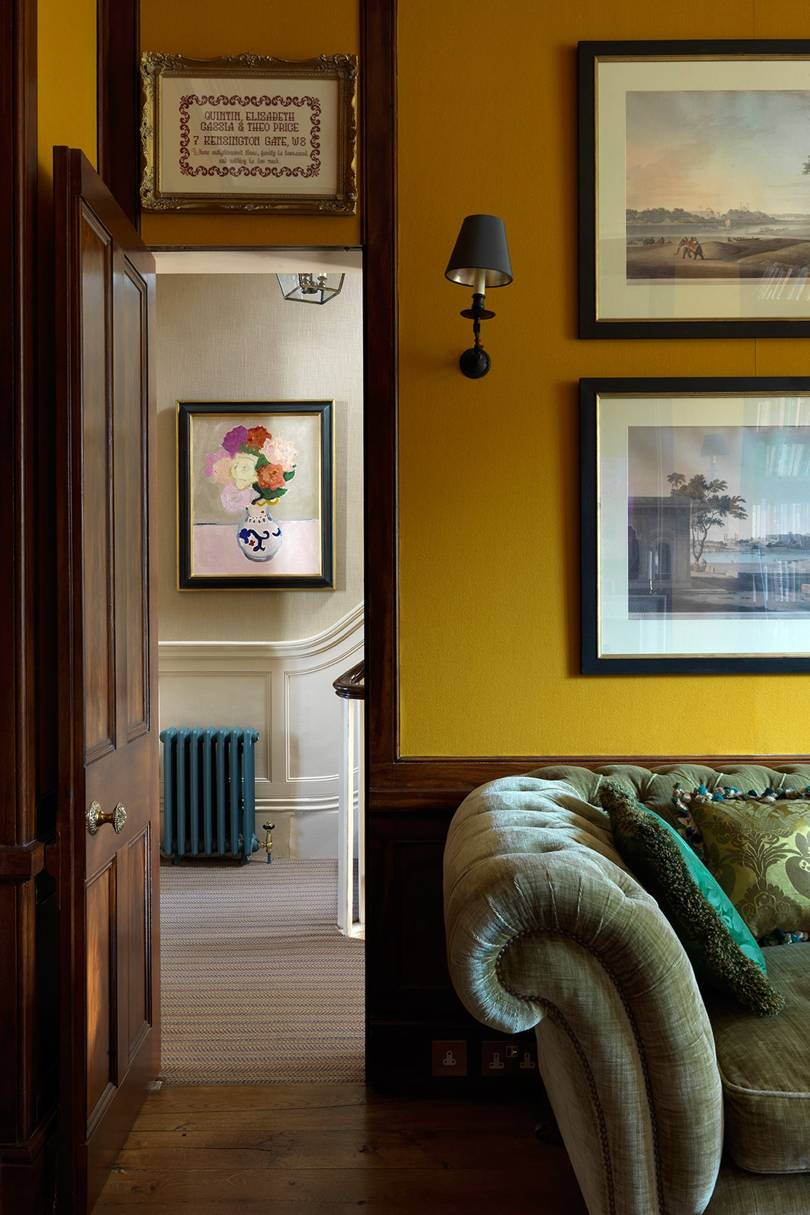 mustard yellow wall house and garden