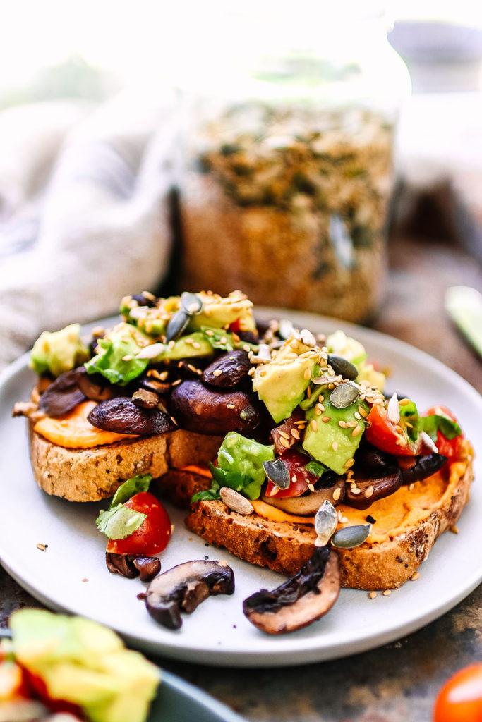 red pepper hummus and mushroom on toast