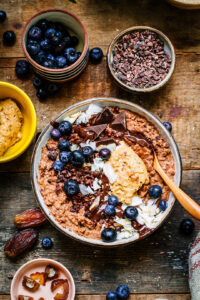 Peanut butter and chocolate porridge with blueberries