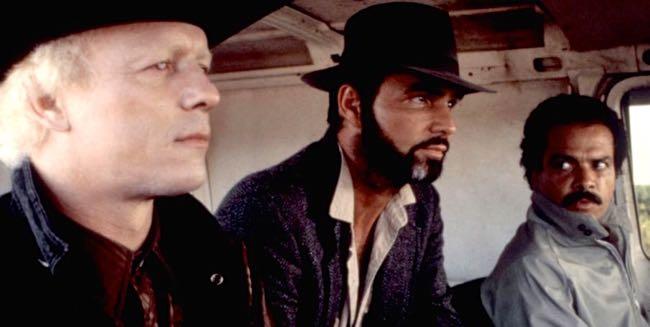 STICK, Dar Robinson, Burt Reynolds, Jose Perez, 1985. ©Universal