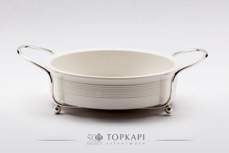 White round porcelain plate with silver plated stand