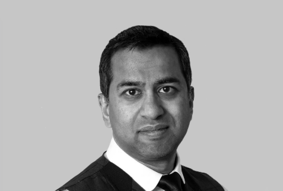 Black and white photo of Dowshan Humzah, independent board director and transformation specialist