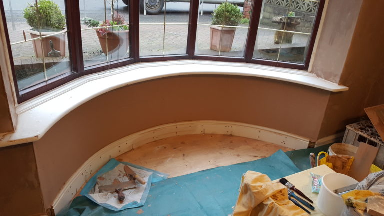 Plastered bay window and shaped skirting board and new floor