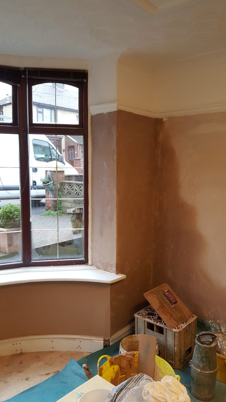 Plastered bay window and shaped skirting board
