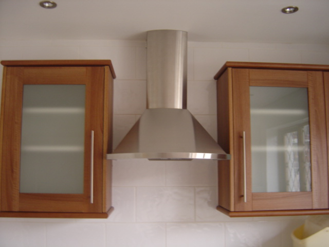 brushed stainless extractor fan with oak wall units