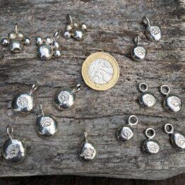 Chilli Designs paw print pendants