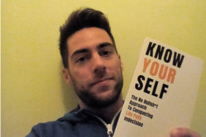 """Stefano Pecci with his book """"Know yourself"""""""