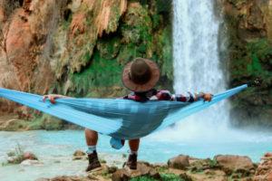 Man with hat sitting in hammock