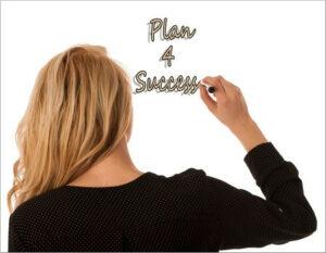 "Woman writing ""Plan 4 success"" on a white board"