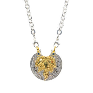 "SOLD Regal Medallion In Silver With Sapphires And Gold ""Playa"" Highlights"