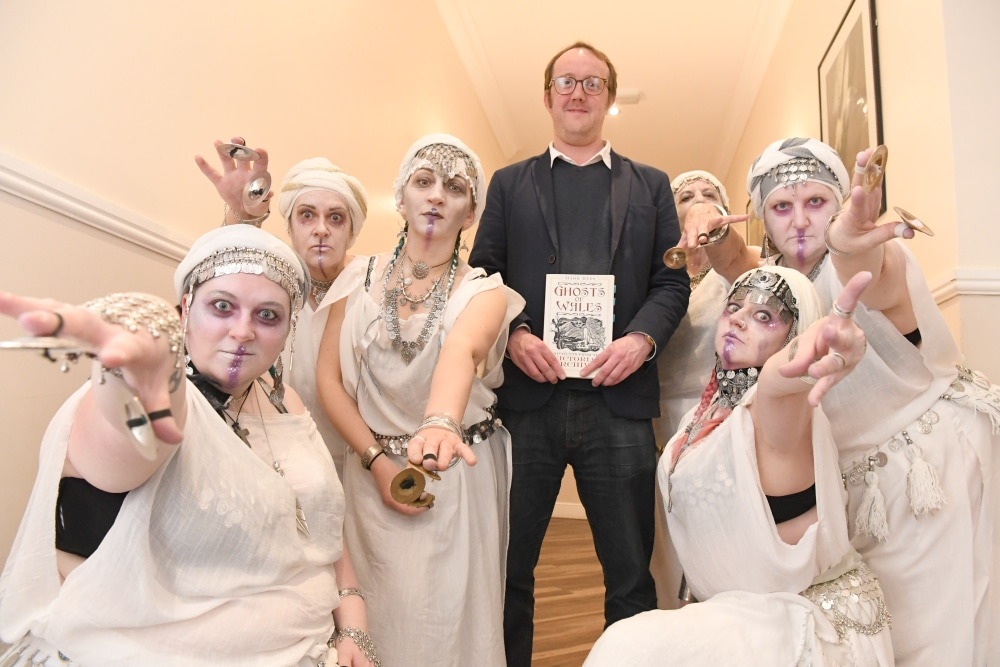 Mark Rees with the Lotus Sisters folkloric belly dancers at the Ghosts of Wales preview at Swansea Grand Hotel. Photo by Gayle Marsh.