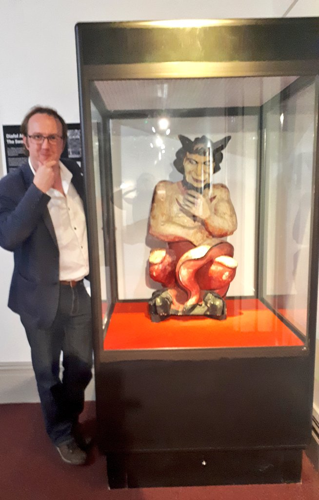 """Mark Rees with the Swansea Devil at Swansea Museum during a """"Ghosts of Wales - Live!"""" event"""