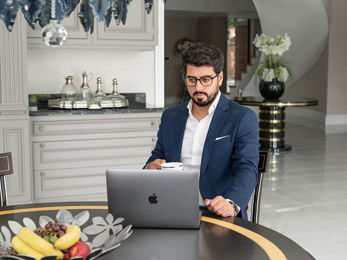 Zain Ali from Centuro sitting in front of laptop
