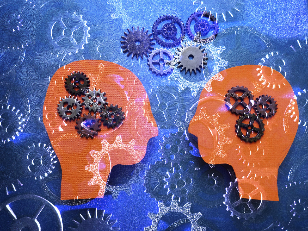 Two heads facing each other with gears background