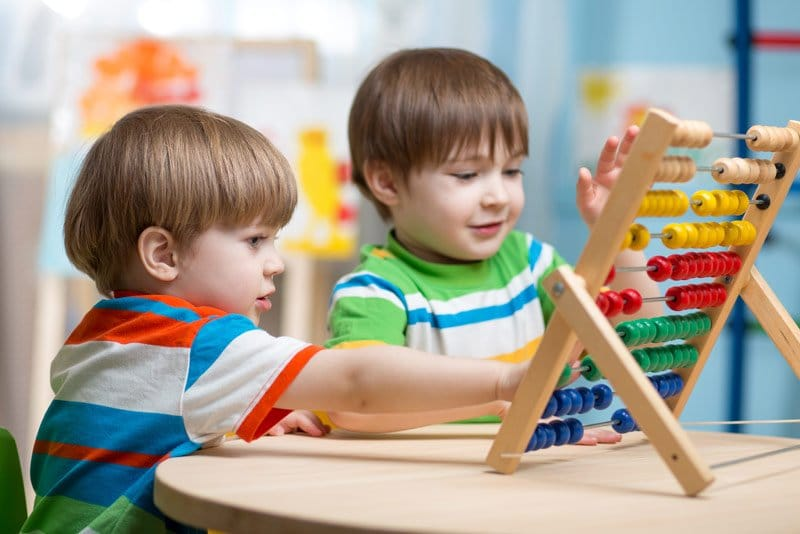 children playing with abacus